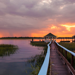 family on dock by John Wollwerth - Landscapes Waterscapes ( beaufort, calm, reflection, wood, relax, yellow, travel, storm, landscape, boardwalk, sun, coast, dock, free, sky, nature, cottage, rise, family, dramatic, empty, pier, sunshine, light, evening, rain, activity, water, beautiful, romantic, horizon, sea, lake, tourism, rainstorm, scenic, morning, south carolina, vacation, red, color, blue, silence, scene, view, natural )