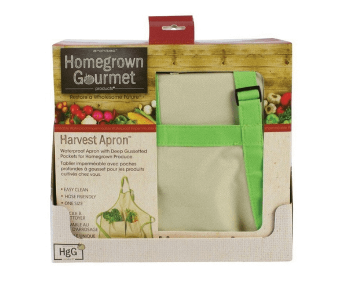Green and beige canvas apron folded into a brown and beige product box.