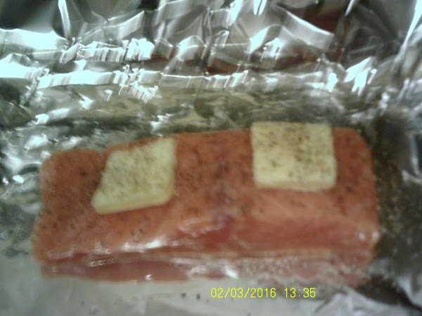 Bake salmon with a couple of pats of butter, salt and pepper for 20...