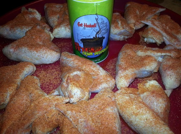 Rinse chicken wings and fold them around the drummettes to form a triangle as...
