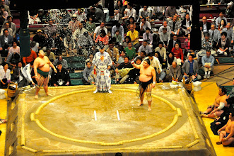 Photo: Shiomaki - throwing salt to purify the ring.