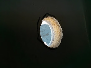 """Photo: New 1-7/8"""" hole in hull above waterline.  Note deck is 1"""" thick with foam core."""