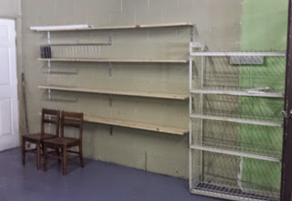 Photo: Volunteering at Clara Muhammad School to help set up their library - empty shelves