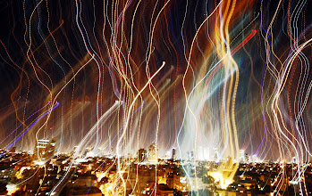 Photo: I was experimenting with slow shutter to capture a feeling in the air over Tel Aviv