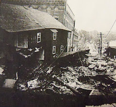 Photo: A collapsed building at the corner of Bridge and Main Streets.
