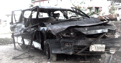 Photo: An abandoned car in Belize, seen in 2003. This is not an uncommon sight, there are decaying school buses, trucks and cars here and there.