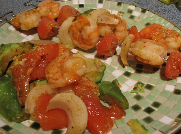 Whiskey apple BBQ & Asian Ginger marinated shrimp, skewered with avocado, tomato and onion.