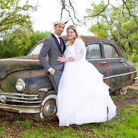 Sneaking Away by Matthew Chambers - Wedding Bride & Groom ( bride, love, dress, wedding dress, groom, after the ceremony, bride and groom, car, wedding day, antique, wedding, posed )