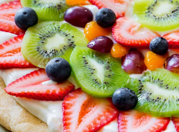 Fruit pizza may be made 1 day in advance, covered tightly, and stored in...