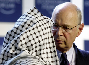 Photo: DAVOS/SWITZERLAND,28JAN01 - President of the Palestinian Authority Yasser Arafat (L) is welcomed by Founder and President of the World Economic Forum Klaus Schwab (R) at the beginning of a session entitled 'From Peacemaking to Peacebuilding' at the Annual Meeting 2001 of the World Economic Forum in Davos, January 28, 2001. Byline: swiss-image.ch/Photo by Remy Steinegger NO RESALES, NO ARCHIVES