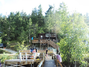 Photo: Looking back up at the cabin from the dock. Cole on theright in black t shirt and Carmen on the left. Gathering stuff for an evening trip on the Huck Finn.