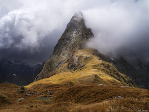 """Photo: The jagged peak of Mt. Balloon cuts through the clouds on Mackinnon Pass, the high point of the <a target=""""_blank"""" href=""""http://www.mountainphotographer.com/milford-track/"""">Milford Track</a>, New Zealand's most famous mountain tramp."""