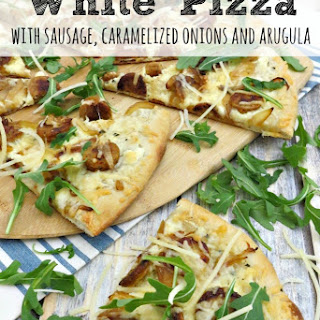 White Pizza with Sausage, Caramelized Onions and Arugula