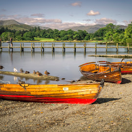 Morning at Ableside by Darrell Evans - Transportation Boats ( pebbles, rowing boat, countryside, ambleside, rope, shore, tourism, boats, bow, transport, birds, water, outdoor, red, lake district, blue, uk, beach, windermere, hills, jetty, row, lake, landscape )