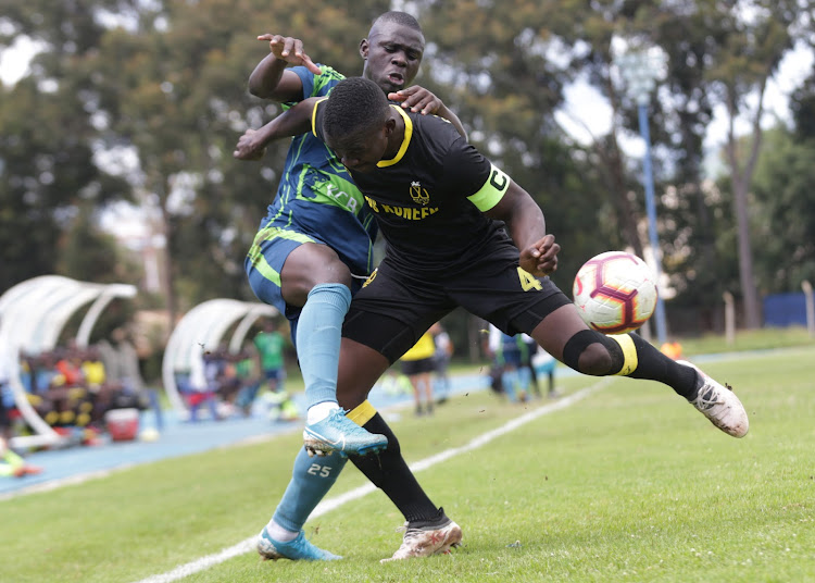 Wazito's captain Bernard Ochieng (right) battles with KCB's Kennedy Owino during a past FKF-PL match.