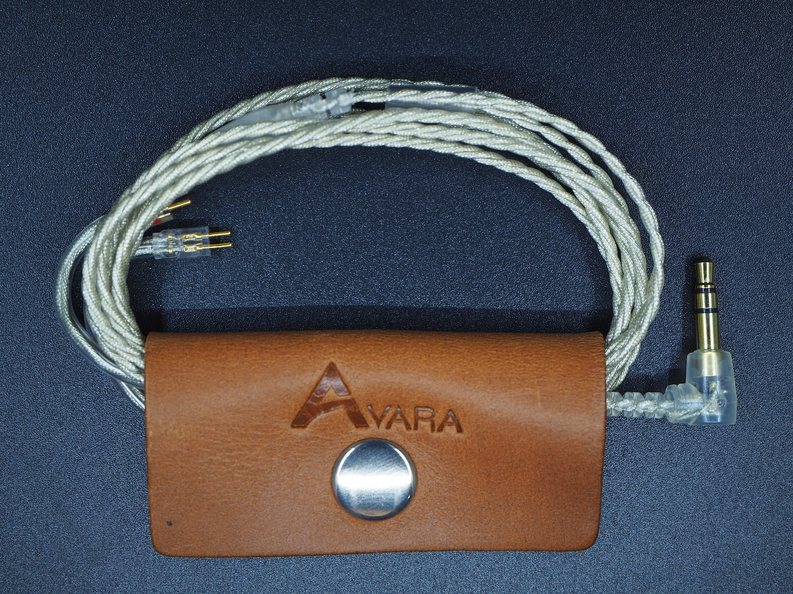 Cable with leather cable management clip