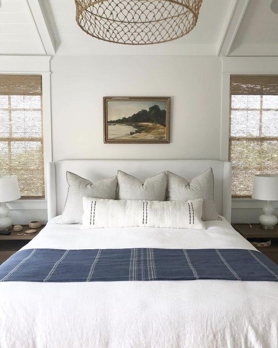 white bed with gray sheets