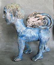"""Photo: 13.5"""" tall x 13.5"""" wide from nose to tail. This is wheel thrown and sculpted pottery. I threw a bottle form for the body and head. I threw columns for the legs and I threw a vessel form for the wings and pressed the feather forms out from the side of the pot, I also threw the spiral tail and the neck. I view throwing as a way to get good sturdy hollow forms to sculpt."""