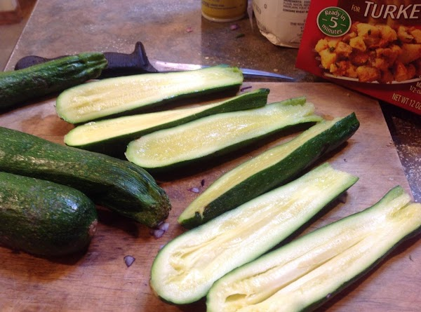 Remove the stems from zucchini, then cut each in half lengthwise.