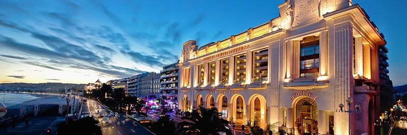 The Hyatt Regency Nice Palais de la Méditerranée in the South of France as night falls.