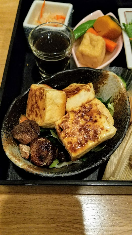 Chef Naoko's Shizuku - a restaurant with natural and organic Japanese cuisine, this is their vegan Shokado, an abbreviated kaiseki meal in a square lacquered box with Ota Tofu Steak