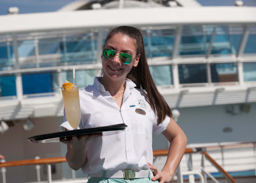 Lucia-on-Ruby-Princess.jpg - Lucia, one of the servers on Ruby Princess, en route to bringing drinks to guests.