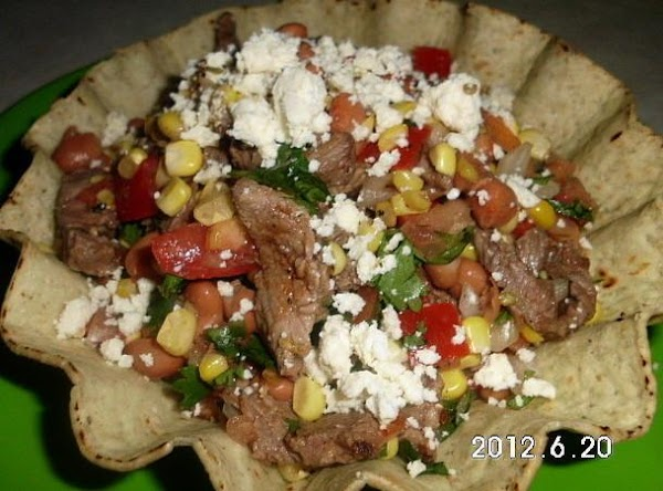 You can also serve in a tostada cup, a taco or burrito with grilled...