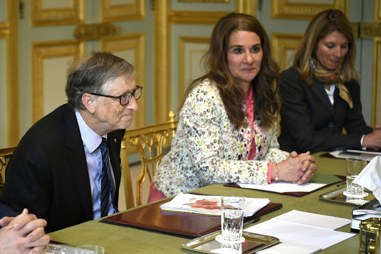 Microsoft founder and billionaire philanthropist Bill Gates, left, and his wife Melinda Gates attend a meeting in Paris, France, April 16 2018. Picture: LIONEL BONAVENTUR/REUTERS