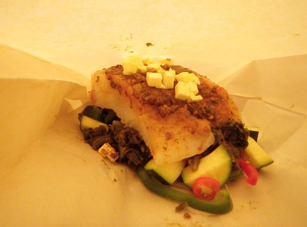 Sprinkle both sides of the halibut with the your choice of rub.  I...