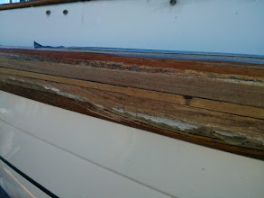 Photo: fitting teak splines along the caprail joint