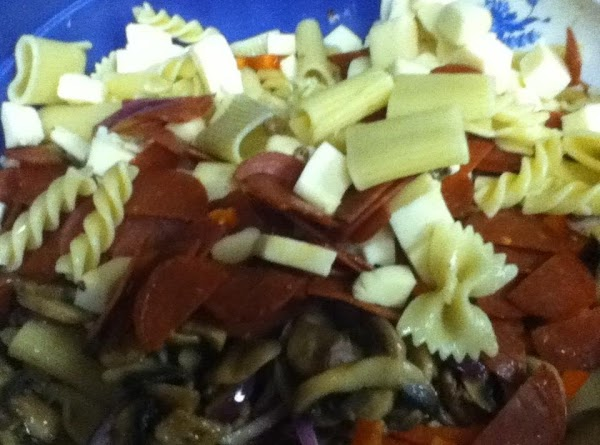Turn out 1/2 of the mix into a large greased casserole. sprinkle half the parmesan,...
