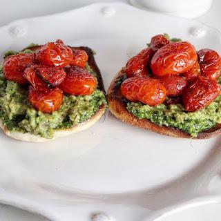 Avocado Toast with Burst Tomatoes and Pesto.