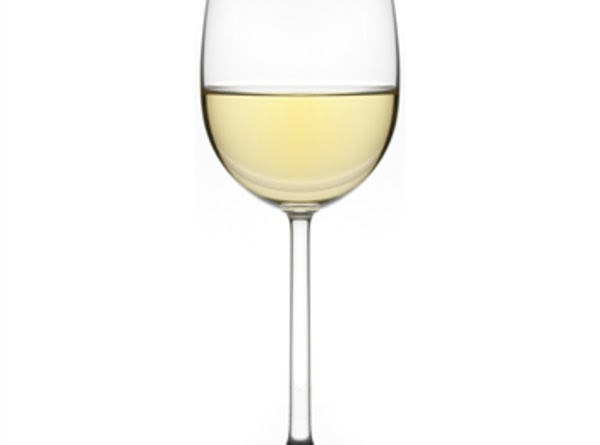WHITE WINE GLASS A clear, thin, stemmed glass with an elongated oval bowl tapering inward...
