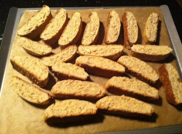 WITH A SERRATED KNIFE CUT 1/2 INCH SLICE ACROSS. PLACE CUT SIDES UP ON...