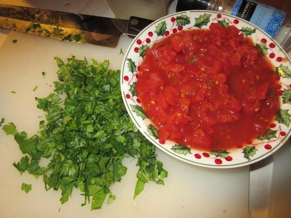Add the can of tomatoes with chilies and the chopped parsley.  Turn the...