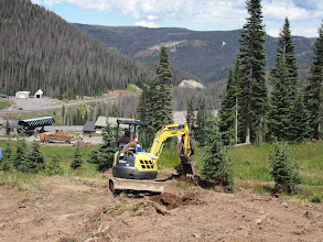 Photo: Adding the final dirt work to the relocated trees on Susan's Run.