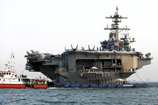 Floating friendship: The US Navy aircraft carrier USS Carl Vinson docks at a port in Danang, Vietnam, on Monday. Picture: REUTERS