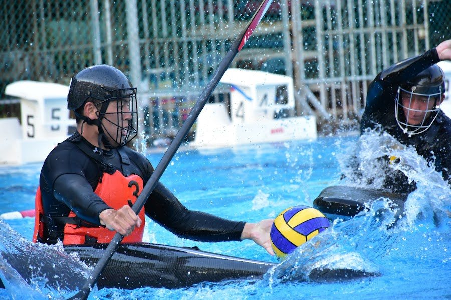 Try to get control of the ball... by Chin KK - Sports & Fitness Watersports ( water, canoe polo, daytime, men, boat,  )