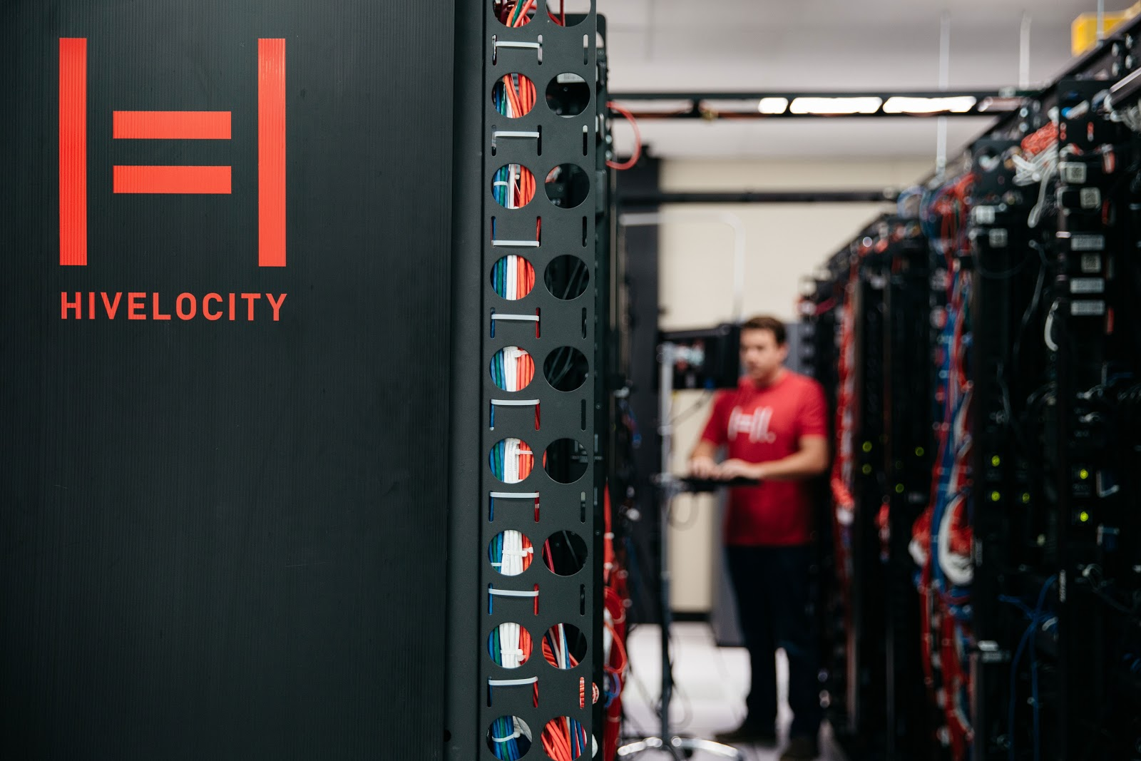Dedicated Servers at Hivelocity's Tampa Data Center. A Hivelocity employee stands close by, ready to assist as needed.