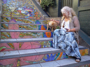 Photo: Mindy and Pumpkin on the Hidden Garden Steps (16th Avenue, between Kirkham and Lawton streets in San Francisco's Inner Sunset District) during their visit from Mendocino County on May 1, 2014. (Pumpkin was traveling incognito after recently having her mohawk shaved off during a seasonal spruce-up.)  For more information about the gardens and the 148-step ceramic-tile mosaic completed by project artists Aileen Barr and Colette Crutcher, please visit our website (http://hiddengardensteps.org), view links about the project from our Scoopit! site (http://www.scoop.it/t/hidden-garden-steps), or follow our social media presence on Twitter (https://twitter.com/GardenSteps), Facebook (https://www.facebook.com/pages/Hidden-Garden-Steps/288064457924739) and many others.