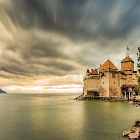 Chillon Castle by Nikolas Ananggadipa - City,  Street & Park  Historic Districts ( clouds, sunset, switzerland, long exposure, lake, castle, yellow, chateau,  )