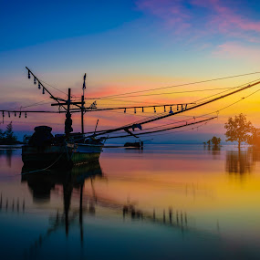 Silhouettes fishing boat and tree at sunset time, Phuket, Thaila by Nuttawut Uttamaharach - Landscapes Waterscapes ( nobody, old, relax, ship, fish, tropical, thailand, thai, travel, beach, landscape, float, sun, coast, tranquil, adventure, sky, rope, lifestyle, evening, water, sand, vessel, white, journey, sea, tourism, vacations, quiet, phuket, scenic, seascape, boat, tourist, sunset, serene, outdoors, fishing, day, sunrise, nautical )