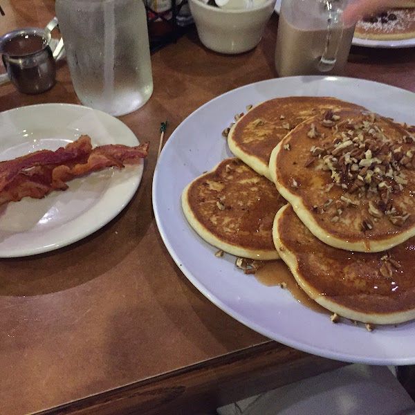 Yummy gf pancakes with pecans and their cinnamon syrup and bacon!