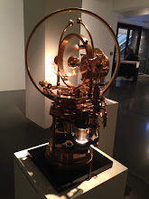 "Photo: The Steampunk Time Machine, Jos de Vink, 2010. The metal sphere appears to be floating inside the rotating gimbal mechanics powered by stirling engines.  Exhibition ""The Mechanical Corps. On the Trail of Jules Verne"", Hartware MedienKunstVerein in the Dortmunder U through July 12 2015, http://hmkv.de"