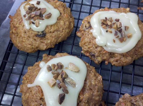 Press about 1/2 teaspoon chopped toasted almonds into the frosting of each cookie. Or...
