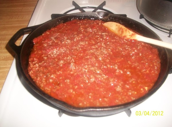 In large skillet, heat 1 tablespoon olive oil and brown ground beef until browned....