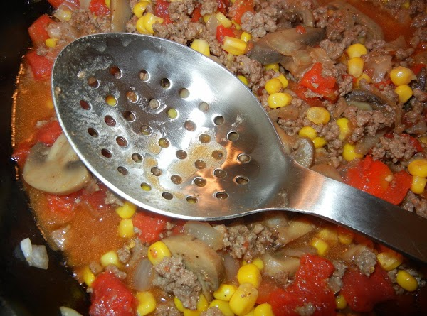 Remove mixture from skillet with a slotted spoon and place in a casserole dish.