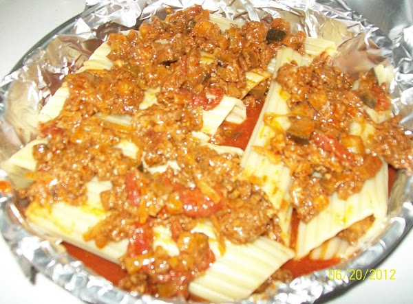 Carefully fill the manicotti noodles. If you have any mole' meat sauce left over,...
