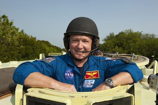 Doug Hurley pauses for a photo during M113 armored personnel carrier training at NASA's Kennedy Space Center.