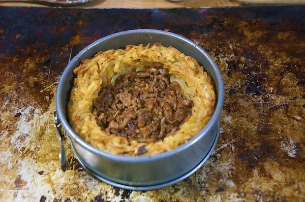 Add half the chorizo, or sausage to the bottom.